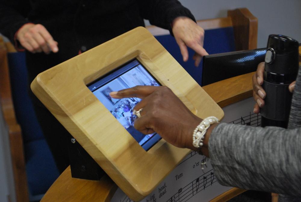 Visitors select Sacred Harp music from a custom iPad app.