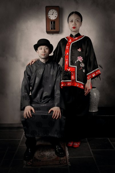 Kerry Huang (seated) and Doan Ly (standing) in a promotional image for  PAPER ANGELS.  Photo by Damian Wampler. Styling by Victoria Linchong. Props by Sinotique.