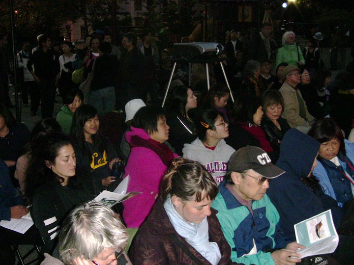 Audience at Portsmouth Square in San Francisco's Chinatown.