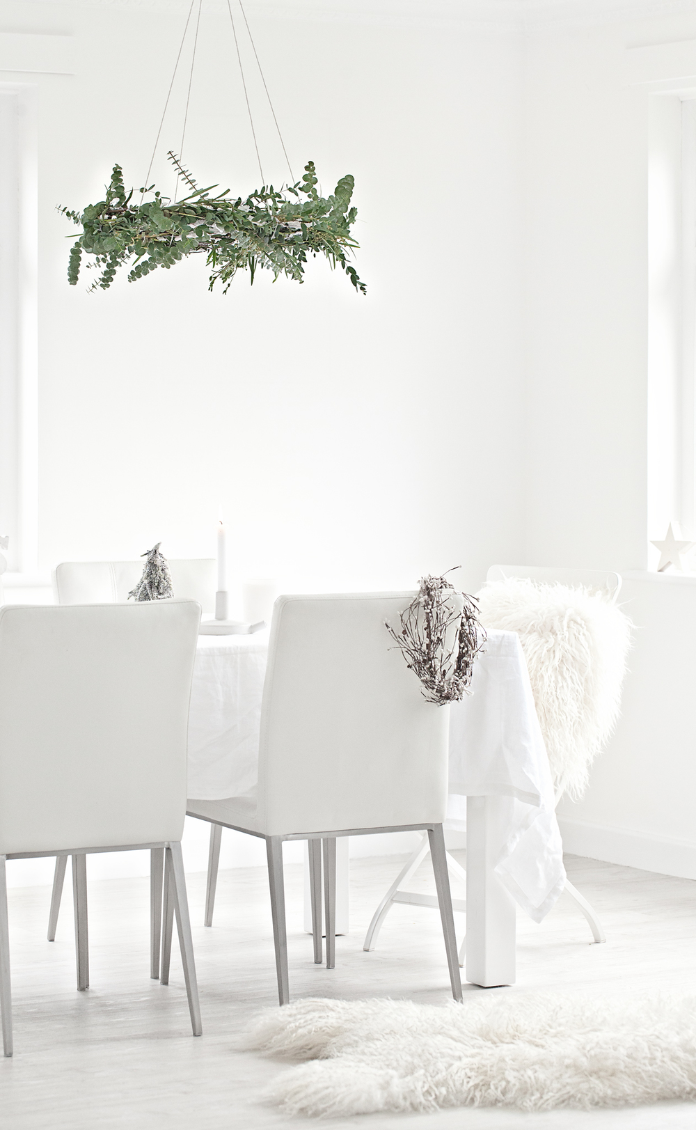 White Linen table cloth from   The White Company   | White Ceramic   Serax   Candle Holder from   istome   | White Icelandic Sheepskin Rug & Cushion from   Milabert