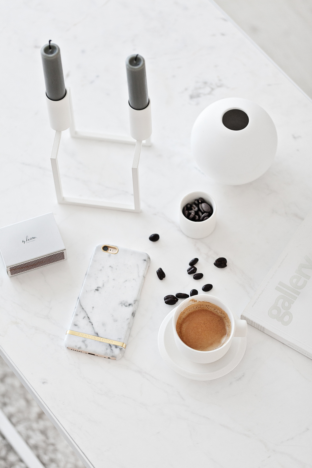 Carrara Marble White iPhone Case from  Richmond & Finch  | Catherine Lovatt White Ceramic Cup from  Serax Belgium  | Line Candle Holder from  By Lassen  | White Ceramic Vase from  Cooee Design