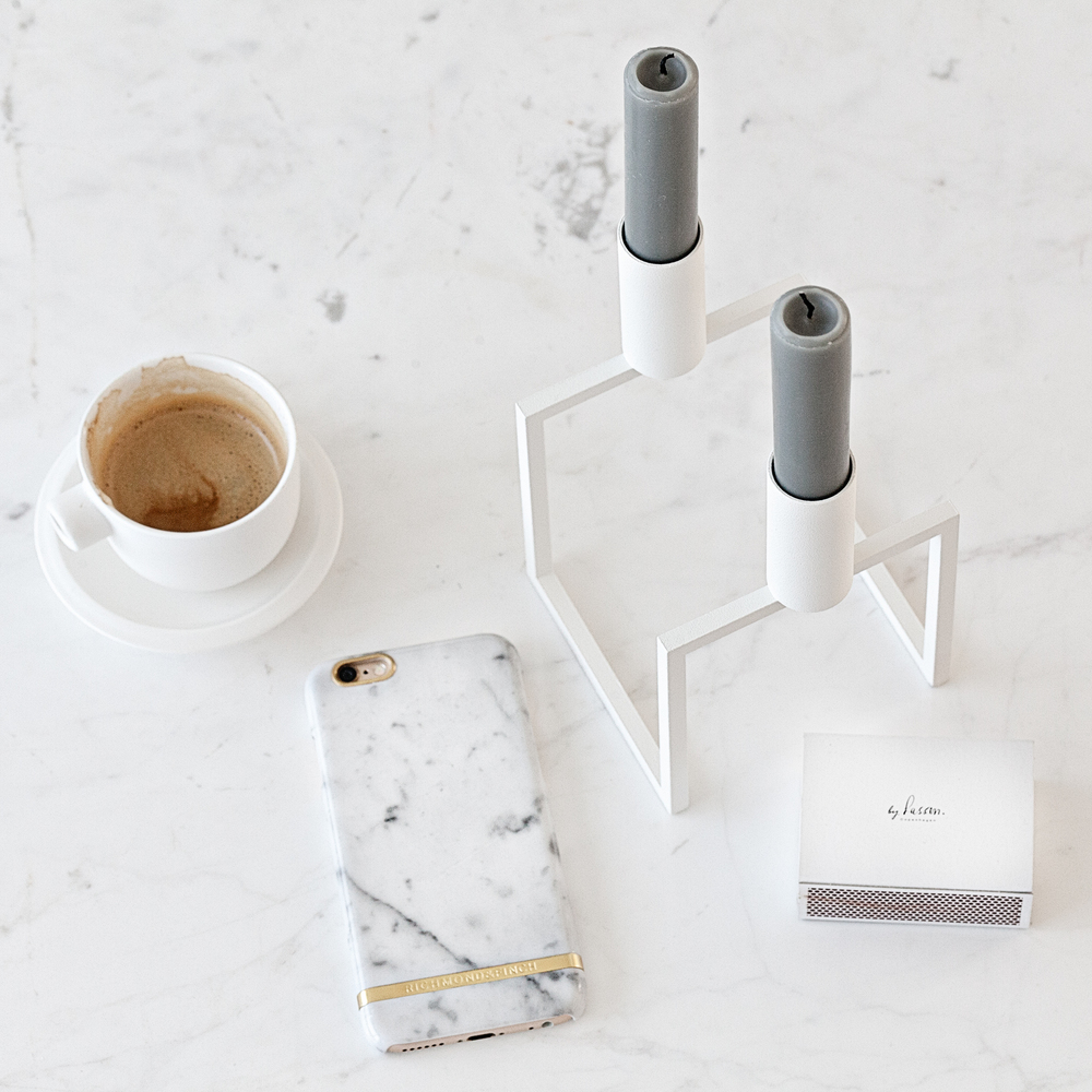 Carrara Marble White iPhone Case from  Richmond & Finch  | Catherine Lovatt White Ceramic Cup from  Serax Belgium  | Line Candle Holder from  By Lassen