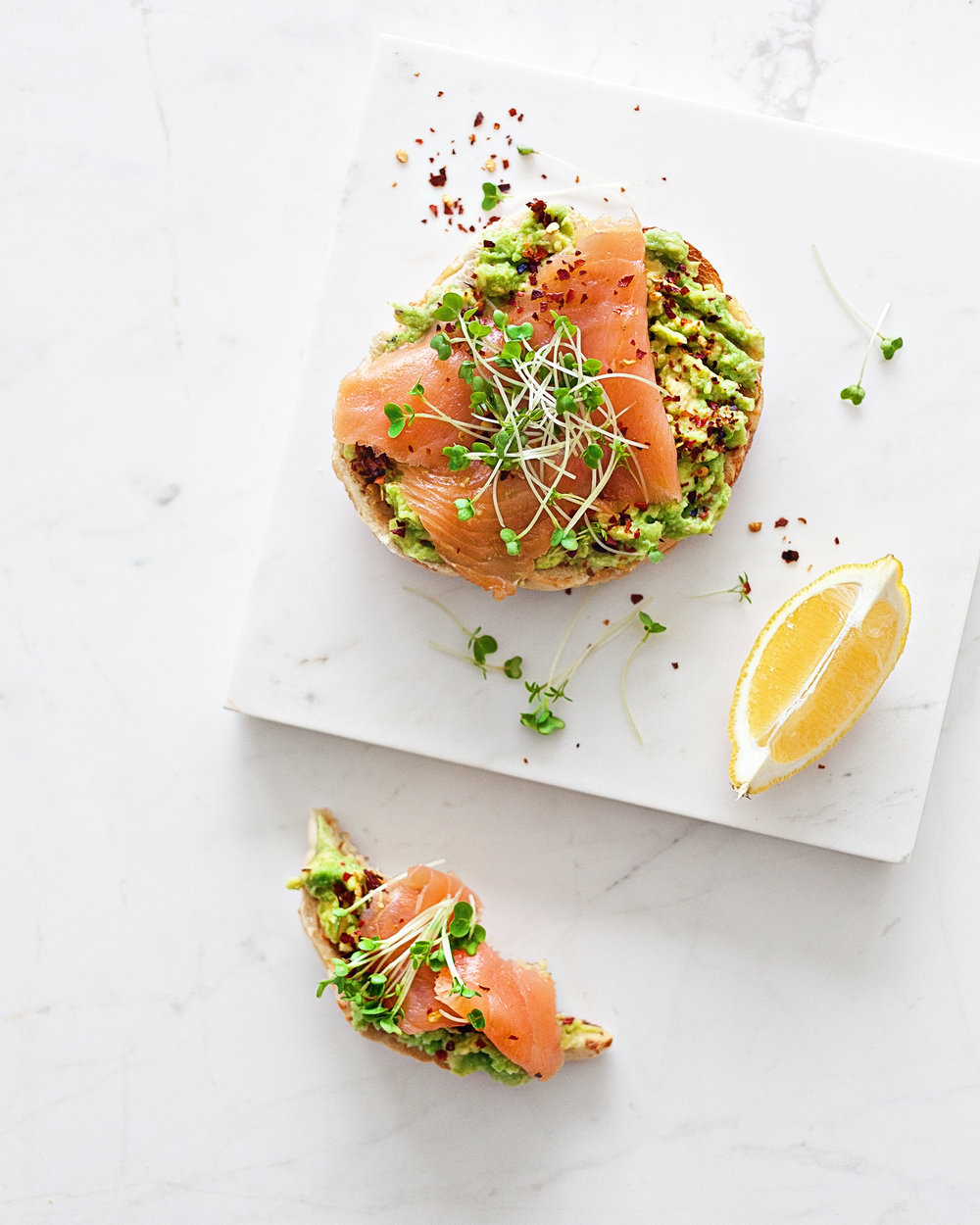 Avocado with Chilli & Smoked Salmon on Toasted Bagels | Marble Table and Marble Serverware from Serax Belgium