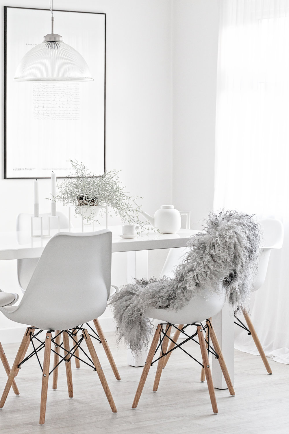Grey Pelssau Sheepskin Rug from Milabert | White Ceramic Tea Pot & Cups from Serax Belgium by Catherine Lovatt | White Eames Style Chairs from Cult Furniture | White Kubus Line from By Lassen & Kubus Bowl from Made Modern