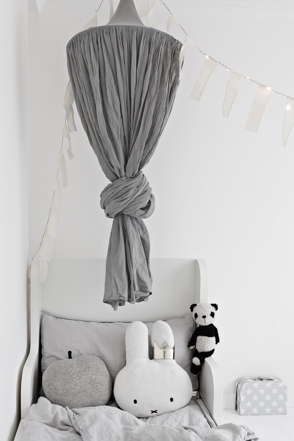 Grey Linen Canopy from Numero 74 | Grey Bed Linens from H&M | Vintage Panda from The White Company | White Bed from Ikea | Bunting from Sukha Amsterdam