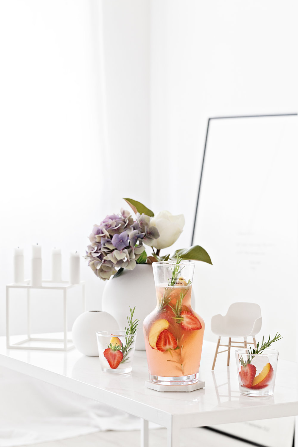 Carafe & Tumbler Set from   The White Company   | Candle Holders from   By Lassen   | Round Ceramic Vases from   Cooee Design   | Form Chair from   Norman Copenhagen  |  White Marble Table from   Serax