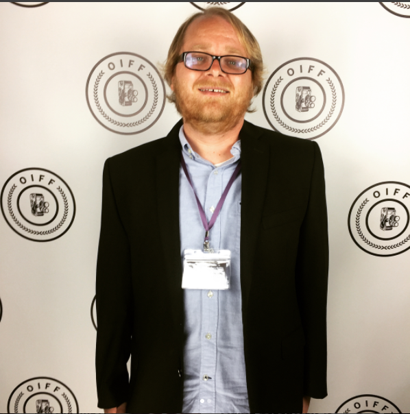 "Director Tyler Nisbet on the red carpet before screening ""Go Tell It on the Molehill"" at the 2017 Oceanside International Film Festival."