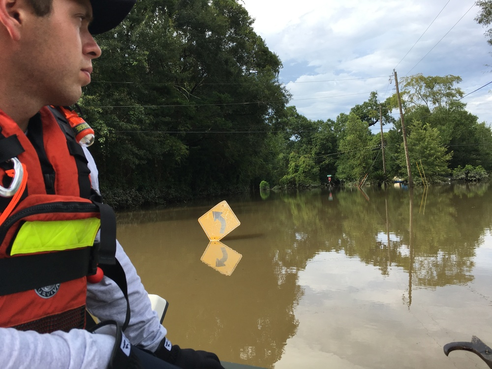 A photo of a member of Texas Task Force 1 conducting search and rescue operations on the flooded streets of Louisiana. August 19, 2016. Photo  FEMA News Photo. FEMA.gov
