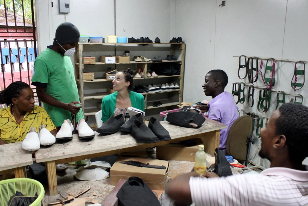 Founder Julie Colombino in the workshop with the team. REBUILD Globally now employs 60 Haitian artisans.