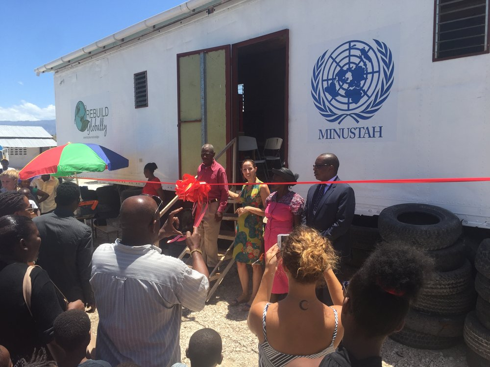 Julie Colombino at the ribbon cutting with the United Nations for the new employment unit at the Fonds Bayard Refugee Camp.