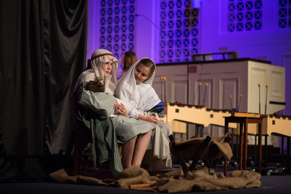 """Mary"" and ""Joseph"" welcome the baby Jesus in our Family worship service, 2015."