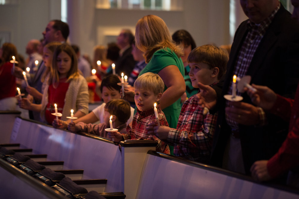 Children participate in candle-lighting at the 4pm Family service on Christmas Eve, 2015. All ages are welcome.