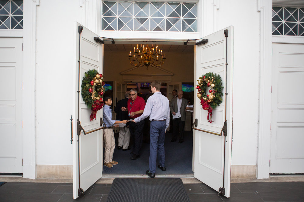 Greeters welcome guests to our Christmas Eve worship services, 2015. This year, you can be a greeter and make the season bright: learn more at  fpco.org/elves .