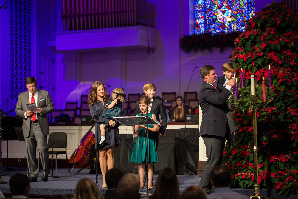 A family lights the Christ candle in our Advent wreath during our Christmas Eve service, 2015. Does your family want to light the candles this year? Email  Lisa  Booth to sign up.