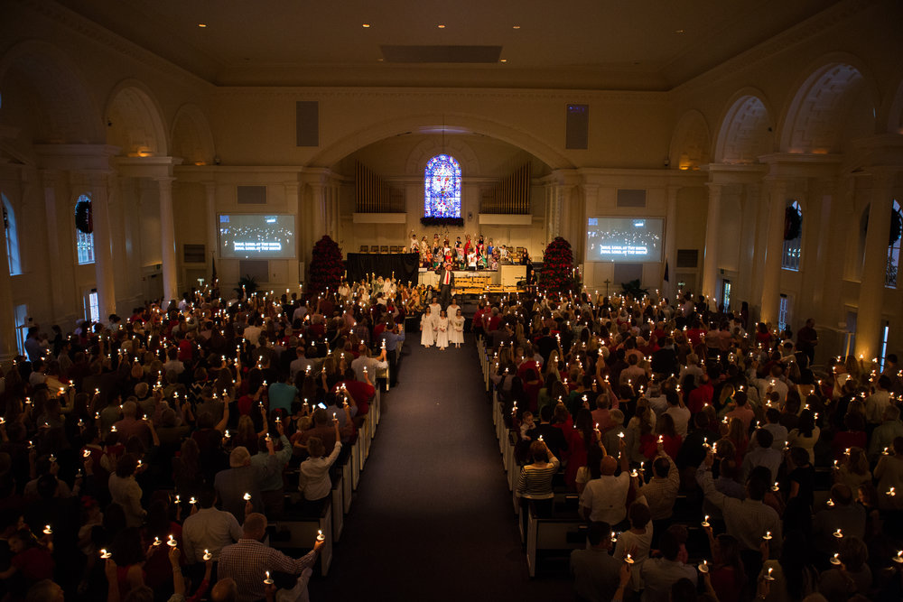 Worshippers hold their candles aloft at the conclusion of our Family service, Christmas Eve 2015.