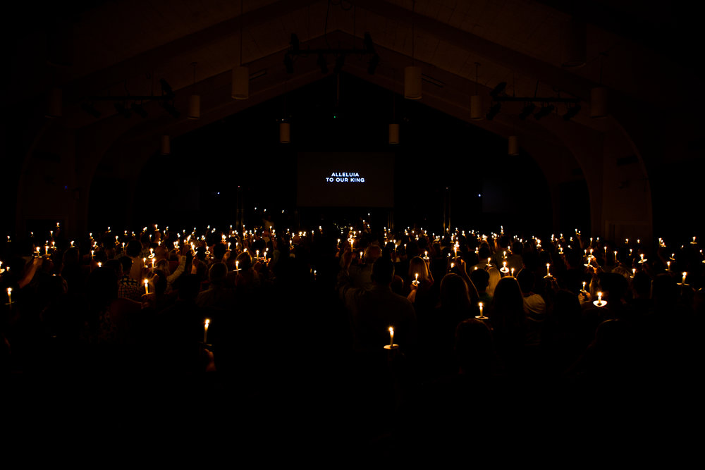 Genesis worshippers hold their candles aloft, Christmas Eve 2105. All of our worship services feature special candle-lighting at the conclusion of the service.