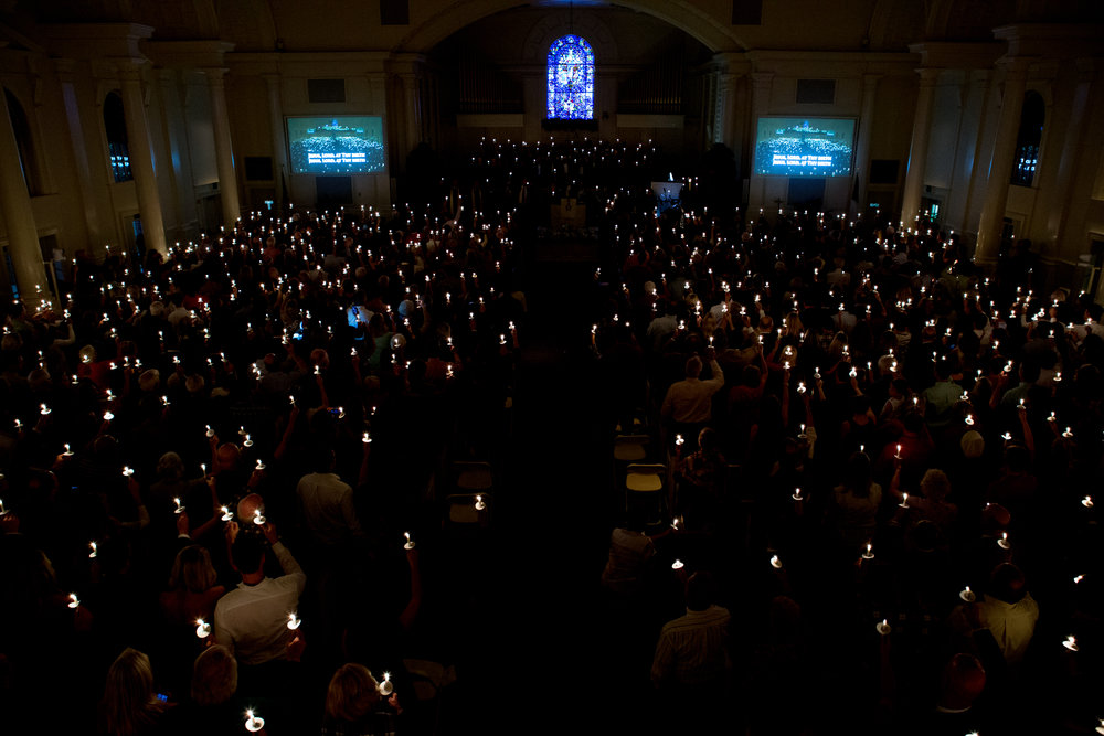 Light fills the Sanctuary as worshippers hold their candles aloft, Christmas Eve 2015.
