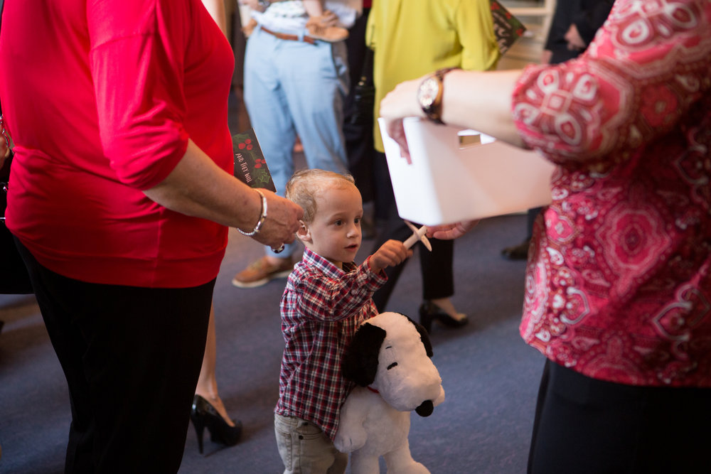One of our smaller participants returns his candle as he exits Christmas Eve worship, 2015.