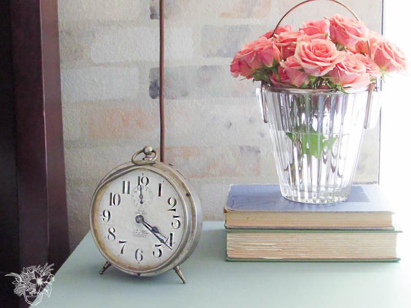 Nightstand clock and flowers