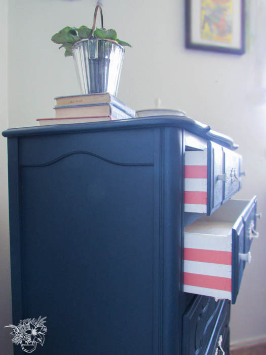Gorgeous navy dresser with pink and white striped drawers. Pocketful Of Posies