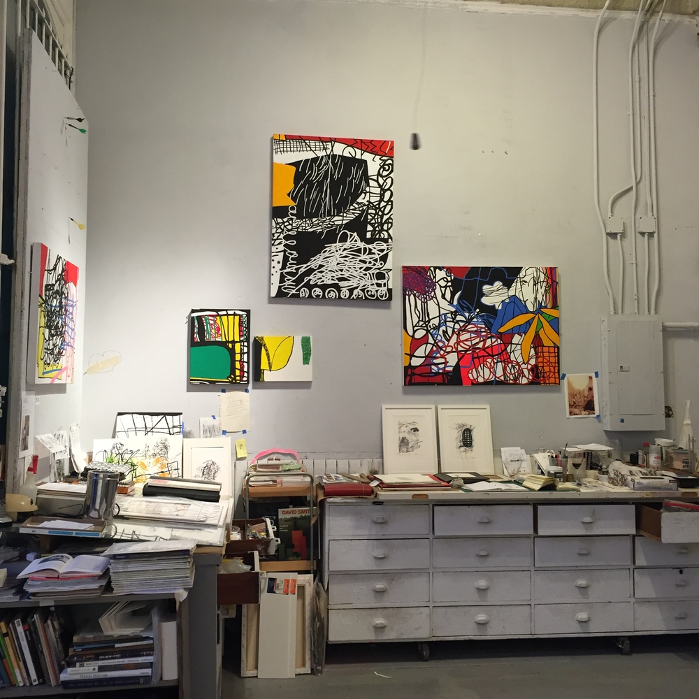 CJ Collins paintings hanging over her workspace