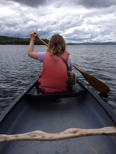 YBC Officer Madison Christgau oars her canoe out toward the loons of Newfound Lake.