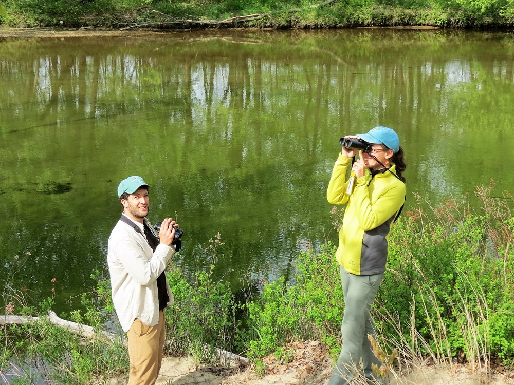 Harriers' Coordinators Phil Brown and Katrina Fenton scan the river during the May Birdathon.