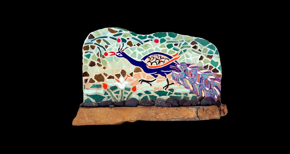 "Peacock II. 14.5x10"". Ceramic, 24 karat gold tesserae, sandstone base."