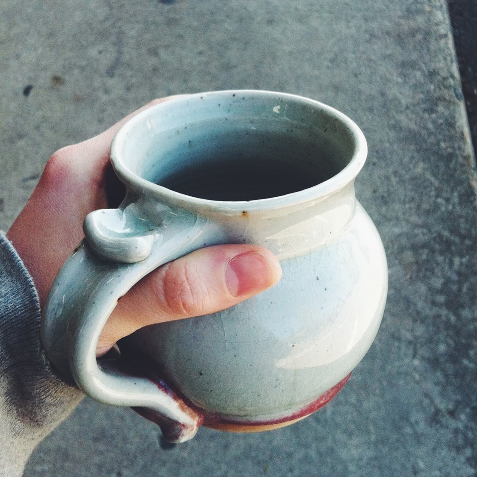 A hand crafted ceramic mug from Ganesh out at Yogaville.