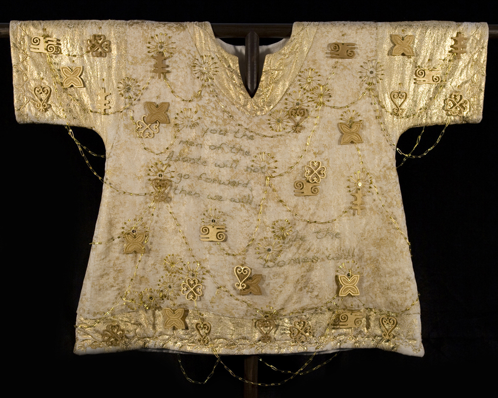 Yaa Asantewaa War Shirt (Ghana)        Materials:  Cotton Muslin, Cotton Batting, Cotton Yarn, Wood, Brass Safety Pins, Bottle Caps, Metal Sequins, Glass Beads, Metallic Thread, Poly/Cotton Thread   Techniques:  Gold Leaf, Laser Cutting, Embroidery, Fabric Painting, Patternmaking, Garment Construction    2009