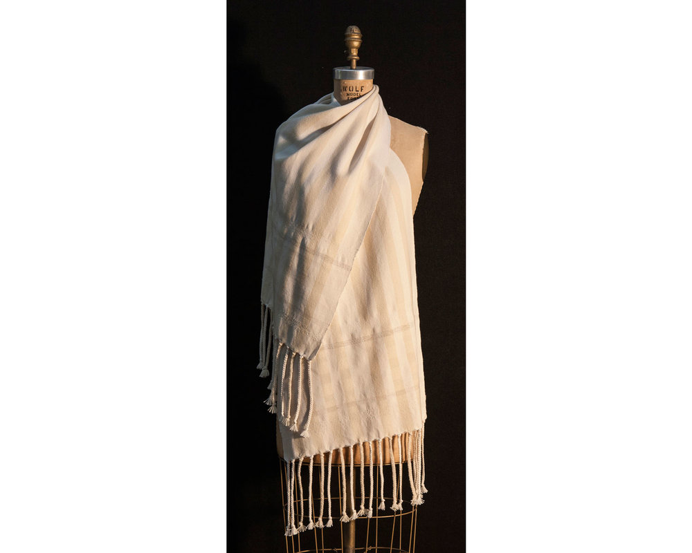 Scarf      Materials:  Cotton, Wool, Nylon, Linen, Flax, Polyester, Viscose, Cashmere, Silk, Acrylic    Techniques:  Hand Woven, Hand Braided    2016