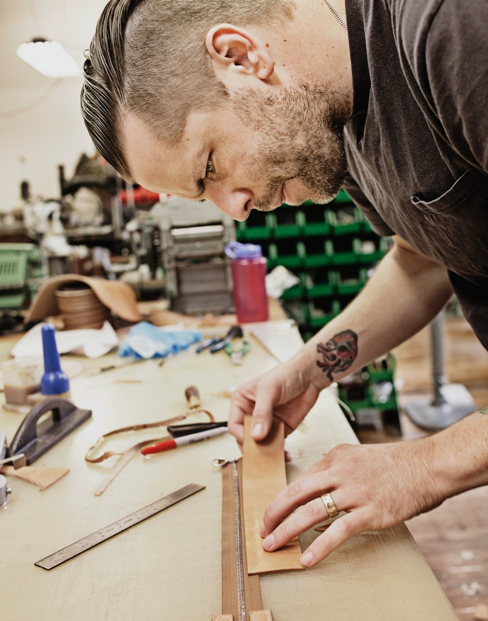 Emil Congdon of Emil Erwin at work in his Nashville, TN studio. Emil Erwin hand makes luxury leather bags and accessories.