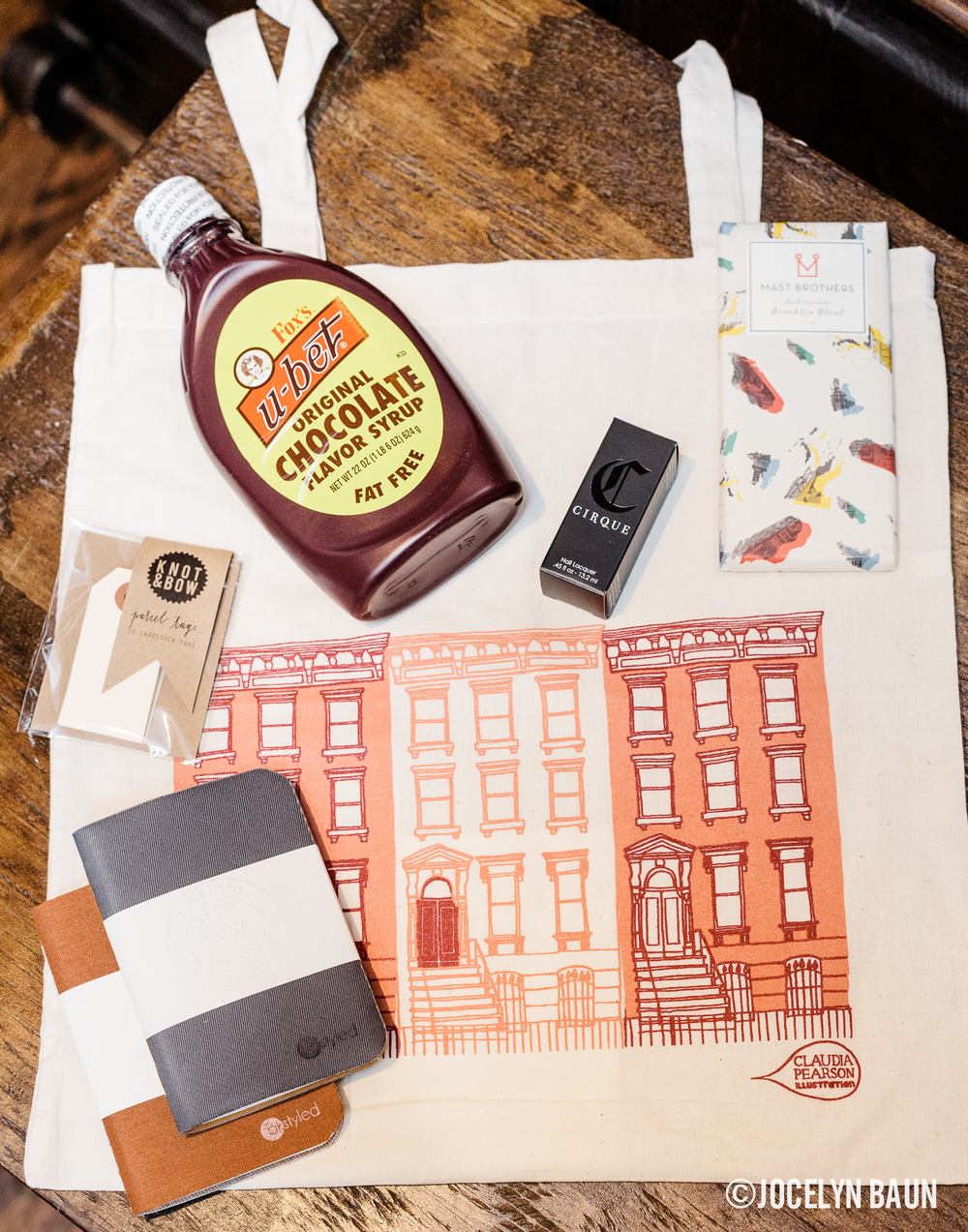 The Claudia Pearson goodie bag included Fox's U-bet chocolate syrup, Cirque nail polish, Knot & Bow parcel tags, a Mast Brothers chocolate bar and a bkstyled fabric notebook.