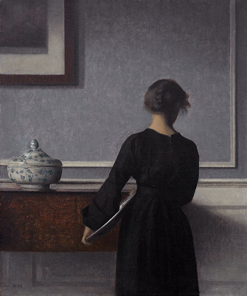 Wilhelm Hammershoi Interior with young women from behind.