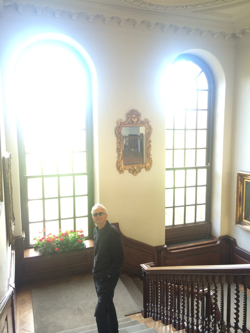 My Dad standing on the staircase inside the main building.