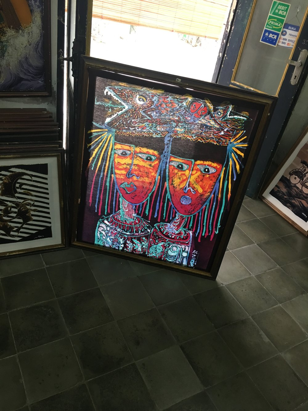 A framed piece of batik.