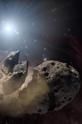 Asteroid Remains Around Dead Stars Reveal the Likely Fate of Our Solar System