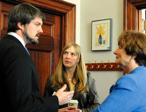 Director Sean Mewshaw and screenwriter Desi Van Til, center, lobby Sen. Elizabeth Mitchell, D-Vassalboro, Monday at the State House for money for a film they want to shoot in Franklin County. Credit: Andy Molloy/Blethen Maine News Service