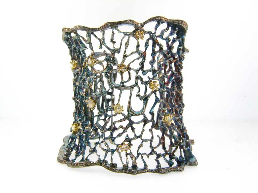 AMAZING oxidized fluorescent diamond web cuff by  Atelier Minyon