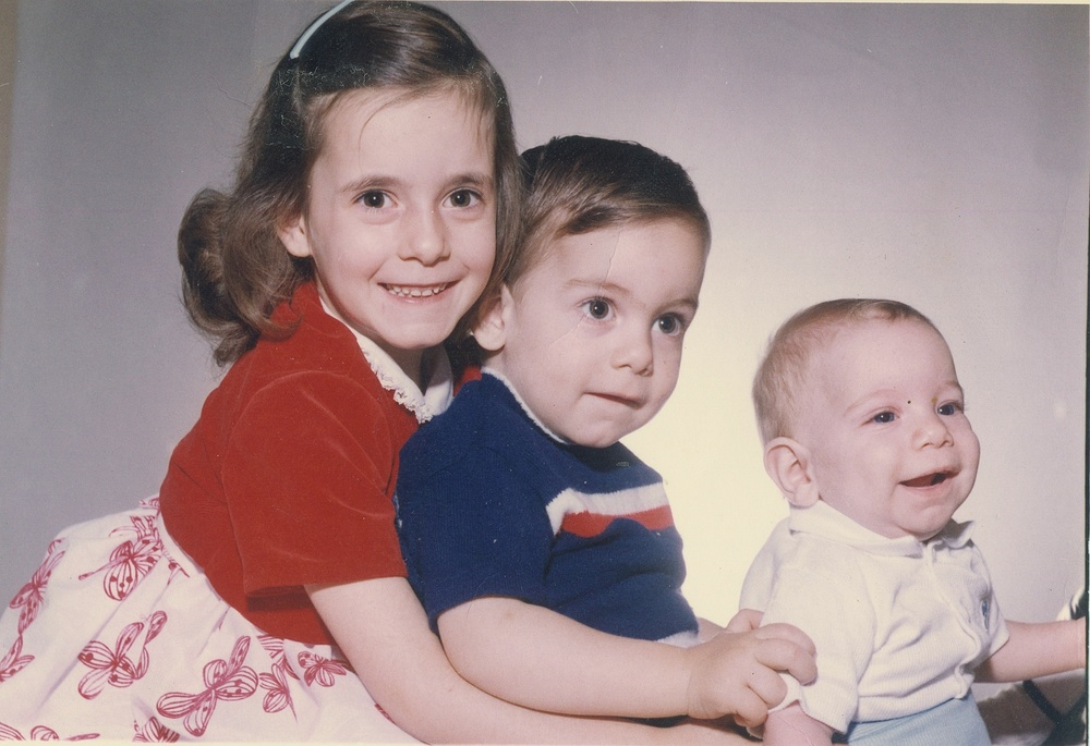 Ms. Sutton as a child with her two brothers, Jeffrey and David (L to R).