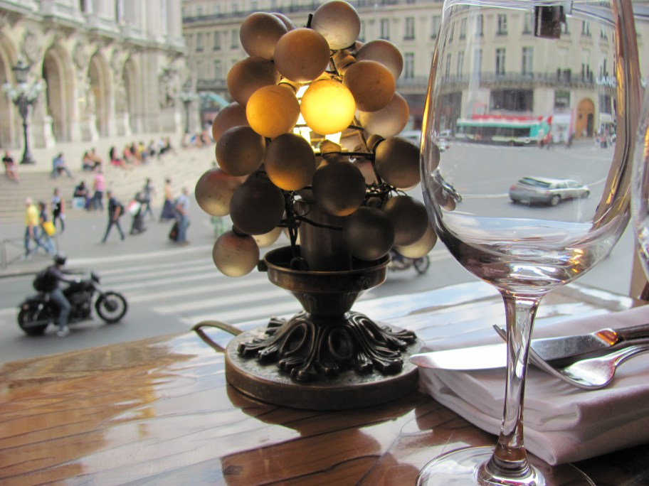 Have lunch in a Brasserie overlooking la Madeleine and unlike me, do not pass up on a nice glass of wine...