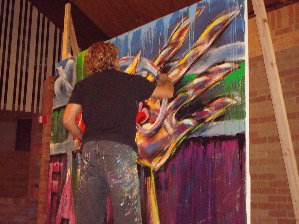 Visual Artist Tom Clark painting at a service