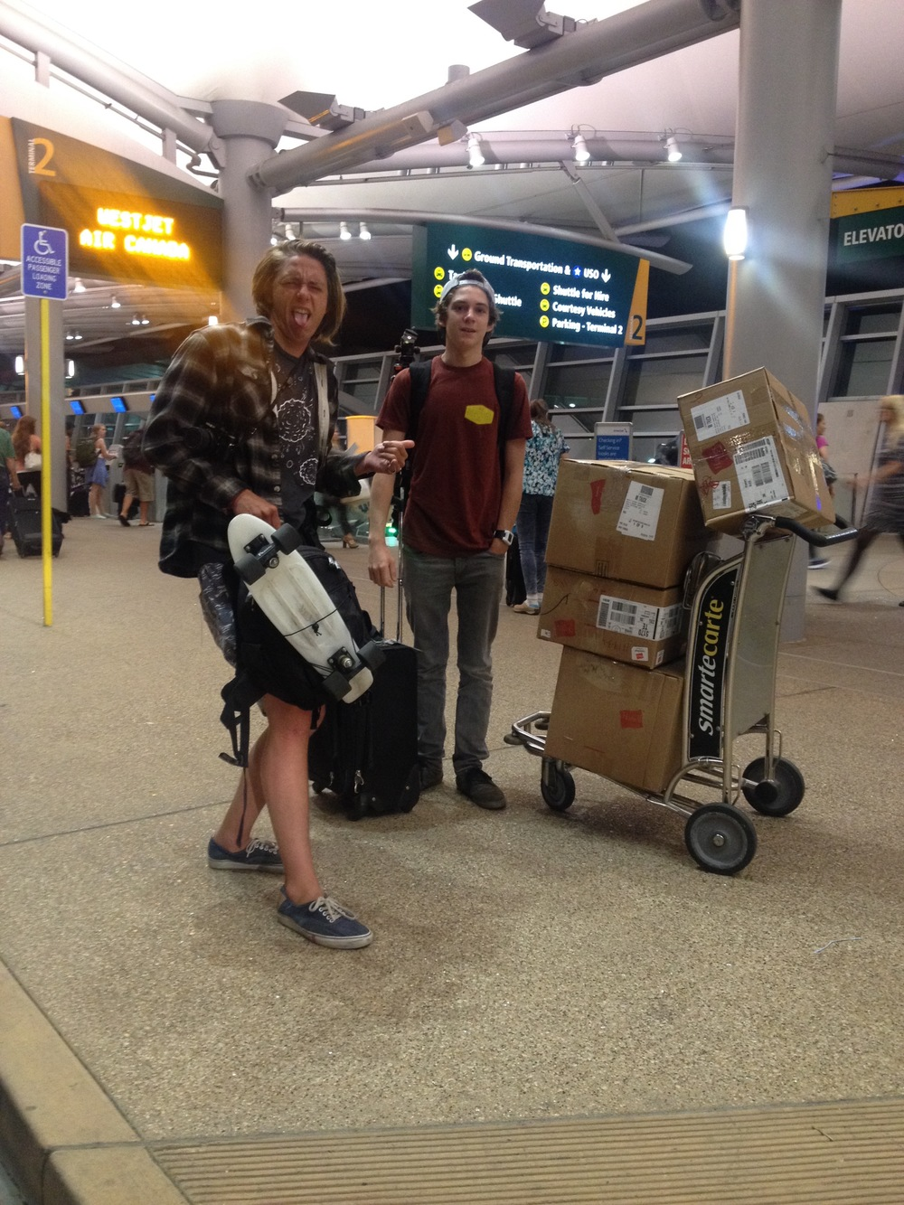 "Trevor and Connor at the airport as we ""dropped them off"". Such an amazing adventure they had together."