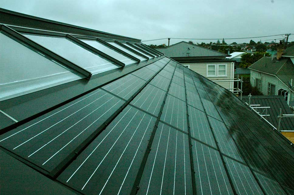 Shot of the completed roof. Eight solar water heating collectors; 88 solar photovoltaic panels.