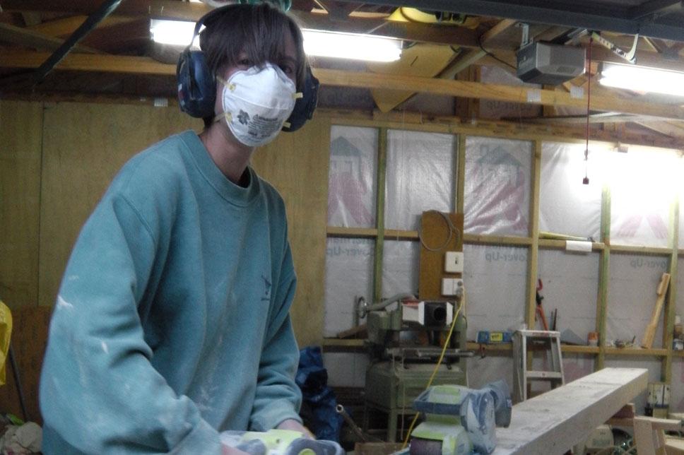 Jo sanding back the beams.