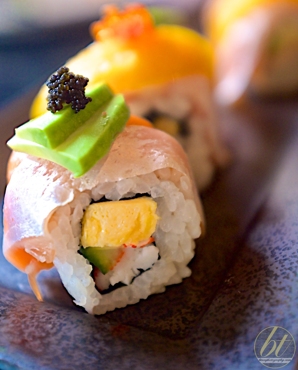 Salmon avocado mango roll ($17.80, 6pc)
