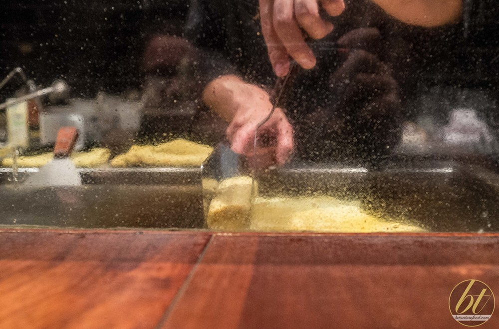 Tamagoyaki being prepared on the teppan