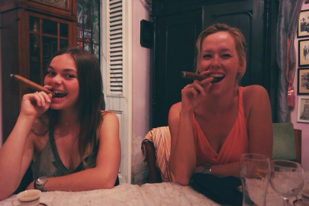 Chloe and I trying to look elegant with our cigars - it's a lot easier for French women I discovered
