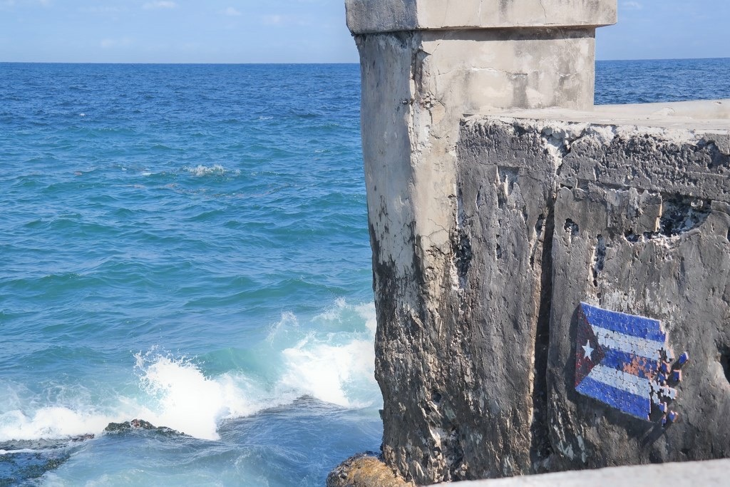part of the wall of the Malecon with a local artist's interpretation of the Cuban flag