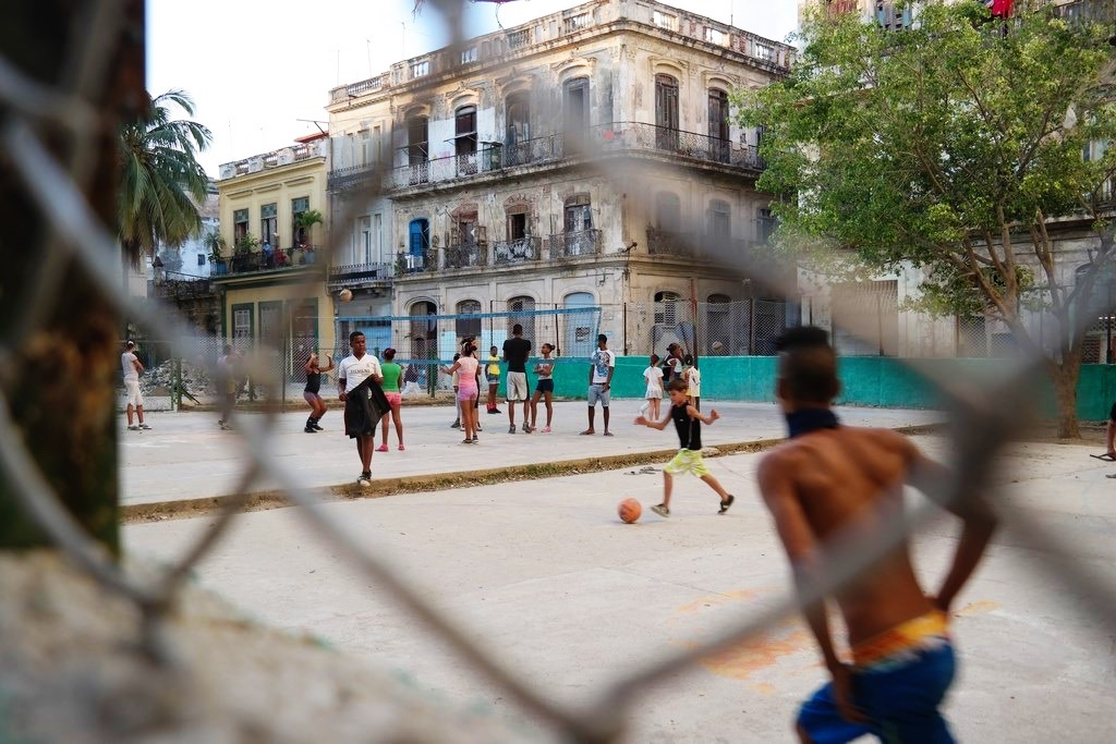 kids playing soccer & volleyball after school in Old Havana